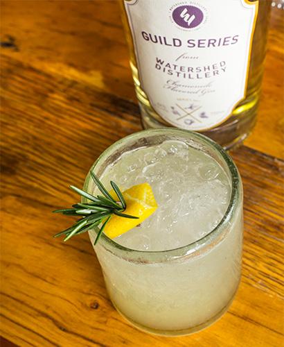 Cocktail with a lemon garnish